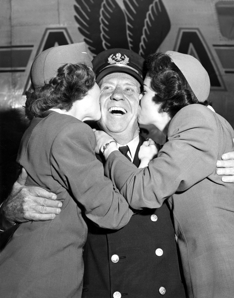 Dad receiving smooches on the occasion of being the first U.S. airline pilot to reach age 60 retirement in 1950. At the time it was a company rule and would not become a federal regulation for another decade