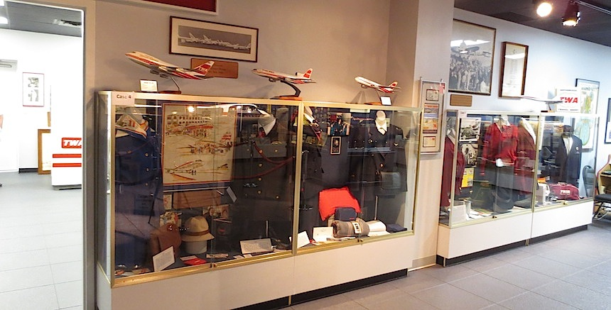 Model airplanes sit atop the uniform display case