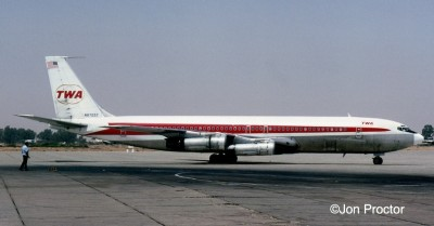 Meeting TWA 707s during our ground stops at Cairo provided a reminder of home and usually U.S. newspapers. 707-331B N8705T is seen arriving with its No. 4 engine thrust reverser stuck in the open position.
