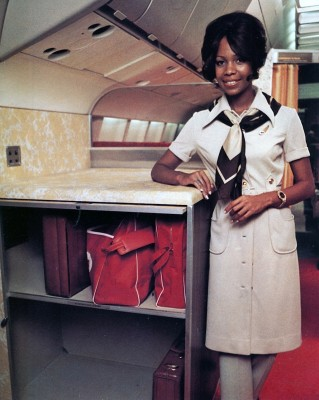 Carry-on luggage compartments helped to compensate for the lack of centerline overhead storage. (TWA)